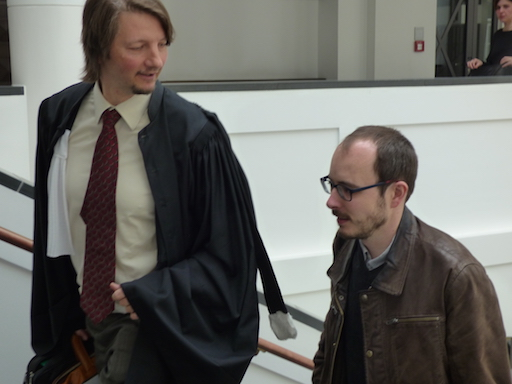 Antoine Deltour and Philippe Penning before the hearing