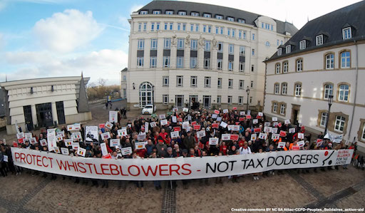 "Around 200 activists behind a banner saying ""Protext whistleblowers, not tax dodgers"""