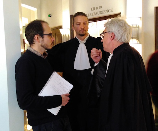 Antoine chatting withd his lawyers, in the court's hall, during the break