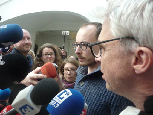 Close-up of Antoine answering to journalists, with Mr. Bourdon