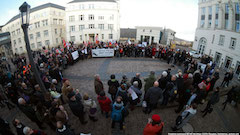 About 200 supporters forming a circle in the courtyard, on the opening day of the appeal trial.